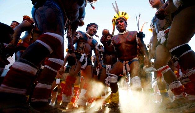 Members of Brazilian indigenous ethnic group Kuikuro dance in Cuiaba