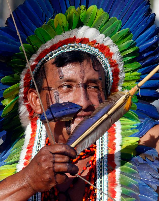 A member of indigenous group Kuikuro aims his arrow during the bow-and-arrow competition in Cuiaba
